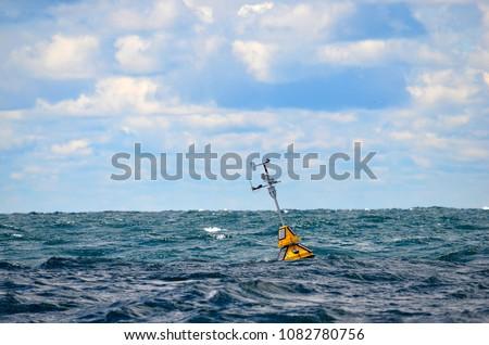 floating weather station buoy on Lake Michigan with horizon background