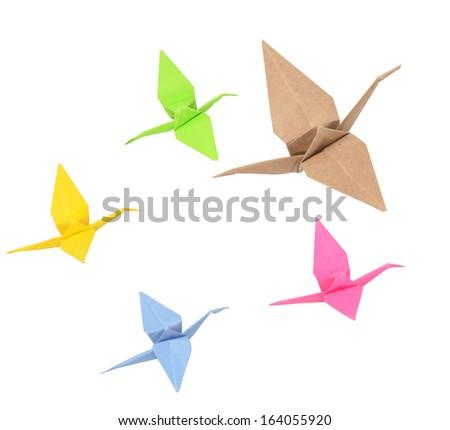 flock of origami birds on white