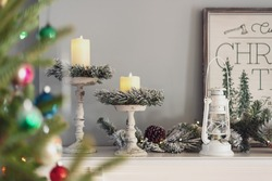 Flocked garland and candle rings on the fireplace mantel at Christmastime