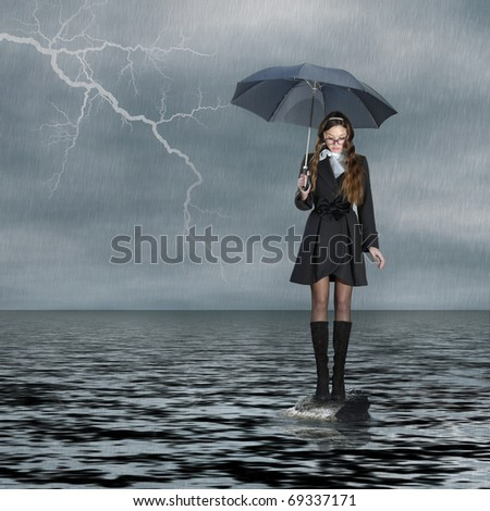 Flood and lightning. Young woman with umbrella standing on water