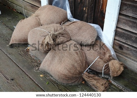 Flood Control, Sandbags. Sandbags stacked in a doorway to prevent flooding.
