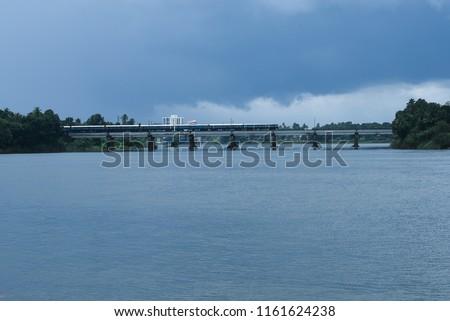 Flood disaster train bridge submerged in Periyar river water in Aluva Kochi.  #1161624238
