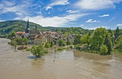 flood due to heavy rainfall at Neckargemund at the Neckar river in southern Germany in early summer