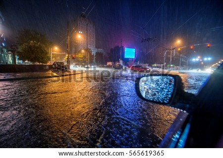 Flood on the road at night #565619365
