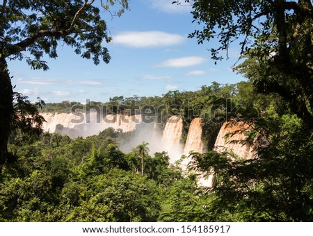 Flood swollen river leading to famous Iguassu Falls on border between Brazil and Argentina