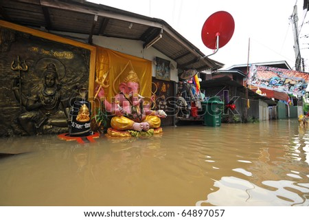 flood waters overtake a house in Thailand