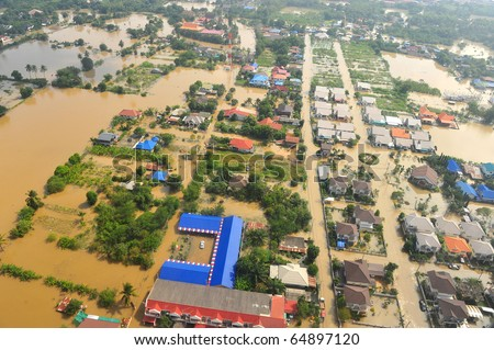 flood waters overtake a house in Thailand form above view