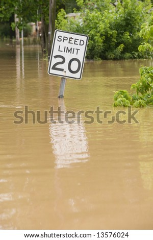 Flood waters overtake a road in rural Indiana
