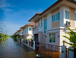 flood waters overtake house in Thailand