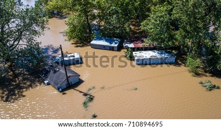 Flood waters totally submerge homes and buildings as hurricane Harvey destroys everything along the Texas gulf coast August 30th 2017 drone view above houses #710894695