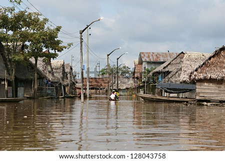 Flooded buildings in the polluted waters of Belen, Iquitos, Peru. Thousands of people live here in extreme poverty without clean water or sanitation.