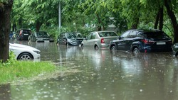 Flooded cars on the street of the city. Street after heavy rain. Water could enter the engine, transmission parts or other places. Disaster Motor Vehicle Insurance Claim Themed. Severe weather concept