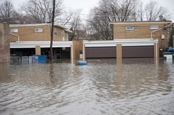 Flooded homes in the Chicago area on a cloudy day.
