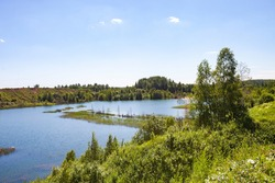 Flooded overgrown sand pit near Sychevo Volokolamsk district of Moscow region. Russia