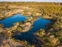 Flooded overgrown sand pit near Sychevo Volokolamsk district of Moscow region. Russia. Aerial view landscape