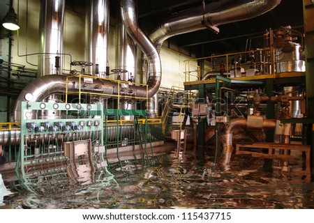Flooded pipes, tubes, machinery and steam turbine at a power plant