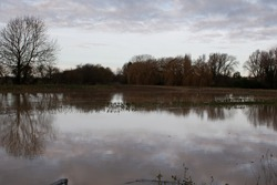 Flooded River Welland, Christmas day 2020, the clouds are reflected in the water.