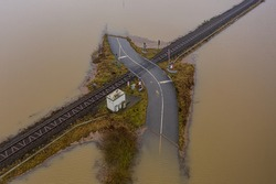 Flooded road passing through the railway. A road under water