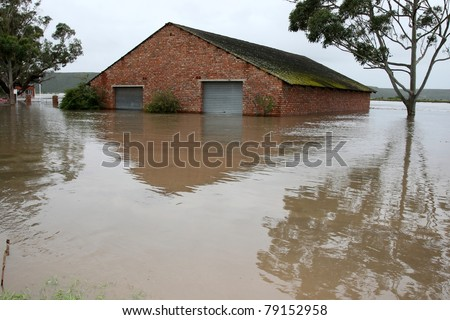 Flooded store room building with water half way up it's walls