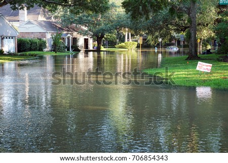 Flooded streets of the neighborhood, drowned cars. Houston, Texas, US. Consequences of the Hurricane Harvey                     #706854343