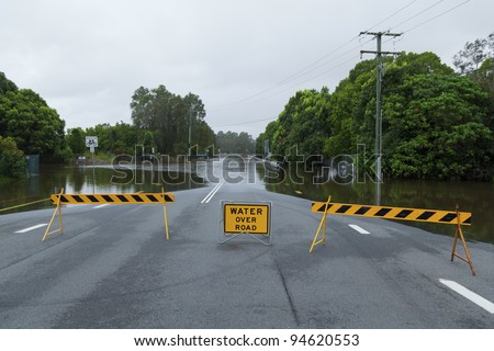 Flooded suburban road with road block in Australia