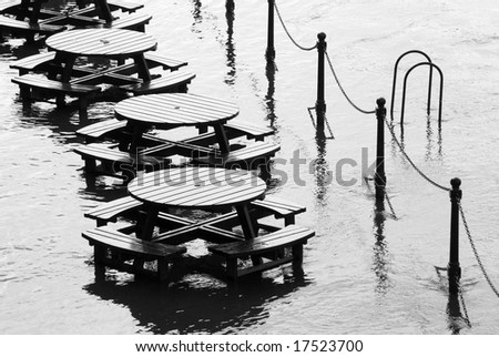 Flooded tables on bank of River Ouse in York.