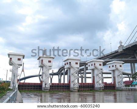 Floodgate with Bhumibol Bridge also casually call as Industrial Ring Road Bridge, Samut Prakarn,Thailand