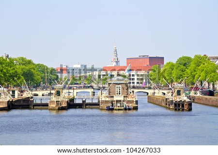 Floodgates in the river Amstel in Amsterdam the Netherlands
