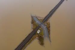 Flooding Germany .Flooded road passing through the railway. A road under water.