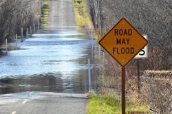 flooding on road and road sign