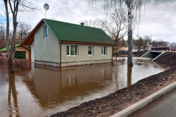 Flooding river flooded town house