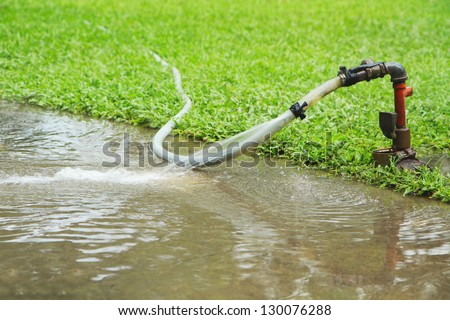 Flooding water running from aged faucet