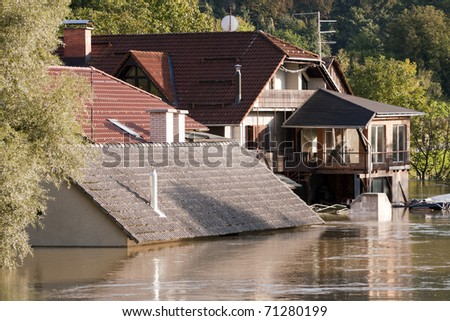 Flooding waters of river Sava and Krka in Slovenia, September 2010 with house under water to the roof.