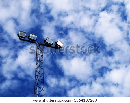 floodlights from below and blue sky with clouds                             #1364137280