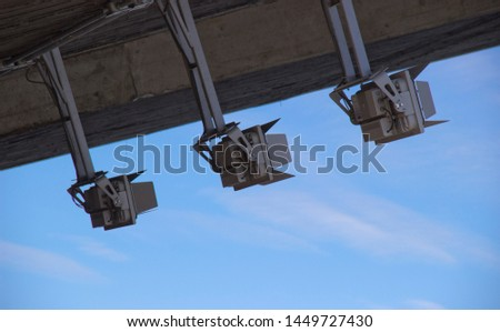 floodlights lighting against the sky in daylight #1449727430