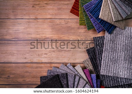 floor carpet samples on brown wooden background with copy space