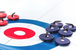 Floor curling sheet with red and blue roller stones for fun indoors or outdoor sport and entertainment activities and kids play. Copy space