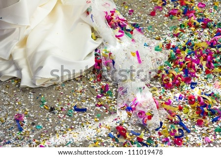 Floor full of rice, paper lace and confetti, after a wedding ceremony.
