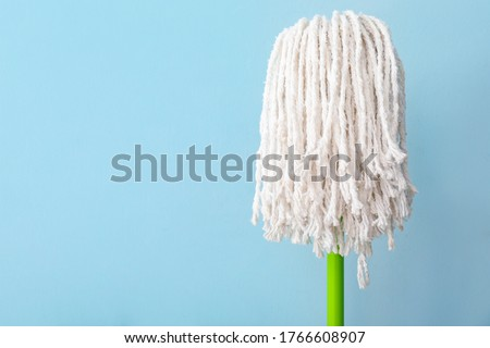 Floor mop on color background Stock foto ©