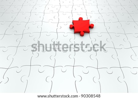 Floor of many grey jigsaw puzzle pieces with a red one
