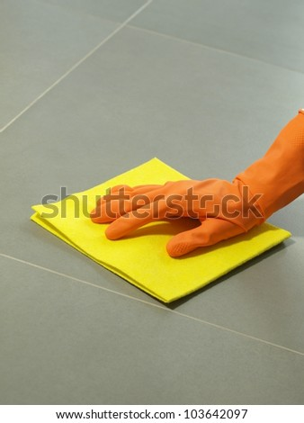 Floor polishing equipment: glove and rubber, closeup