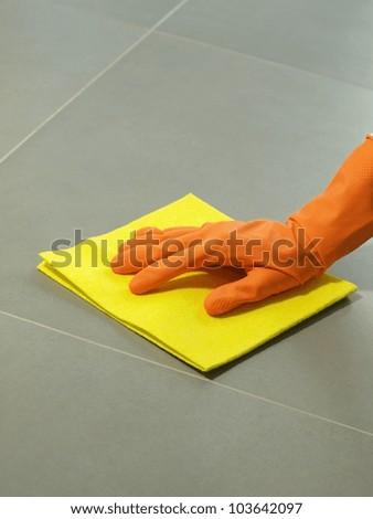 Floor polishing equipment: glove and rubber, closeup