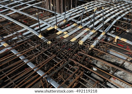 Floor slab reinforcement bar with post tension cable tendon on steel
