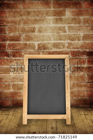 floor stand chalkboard in the brick wall room