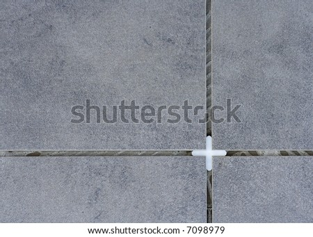 Floor Tiles and Plastic Tile Spacer