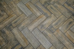 Floor tiles with embossed wood texture. Brown flooring area.