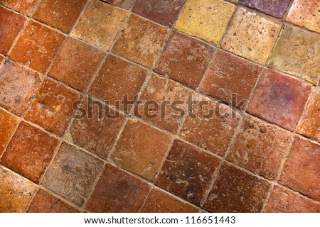 Floor with old tiles inside a French country house