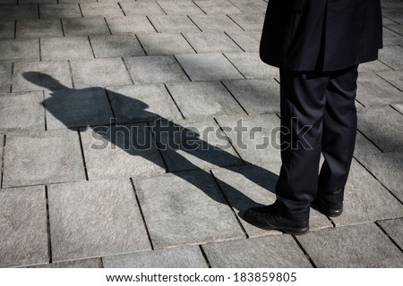 Floor with shadow of a businessman standing