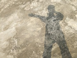 Floor with shadow of young handsome man