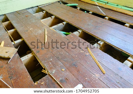 Floorboards lifted by thieves attempting to steal copper heating pipes Stock photo ©
